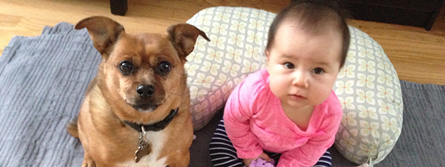 Teaching Children Empathy with a Family Pet | Mariana and her dog strike look-alike poses for the camera. Having a pet can teach both babies and even teenagers empathy.