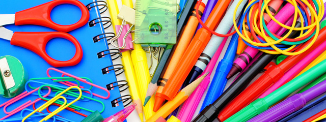 5 Quick Back-to-School Tips for Your Family | A photo of school supplies scattered across a desk.
