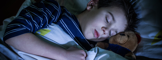 Back to School Routines | A boy sleeps at night.