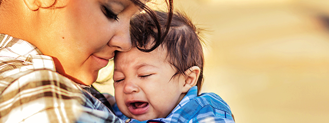 Do you let your baby cry or do you comfort them? | Before you became a parent, you probably talked to your partner and friends and researched what to do when your baby cries. Should you rush to the baby's side and comfort him or her, or should you let the baby cry it out? | A mother holds her crying baby.