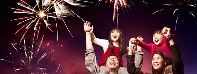 What is your pledge for 2017? | Pledge to encourage your child to do one small thing each day to make his or her world, and in turn, the greater world better. | Two kids sit on their parents' shoulders as they happily watch fireworks.