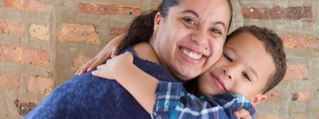 How can I tell if my child is being bullied? | A mother hugs her son.
