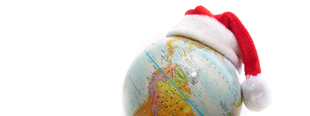 Ho Ho Ho! The Santa Tracker is Back! | A photo of a globe with a Santa hat.