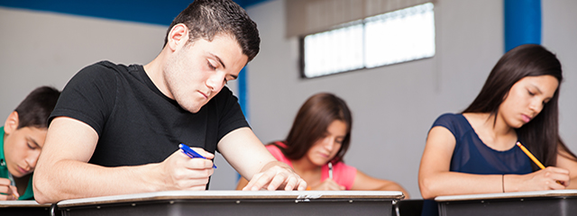 Help Your Student Prepare for College Entry Exams | High school students take an exam in the classroom.