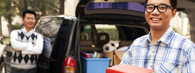 Going Away to College: How to Cope | A freshman unpacks the car at the dorm as his dad looks on.