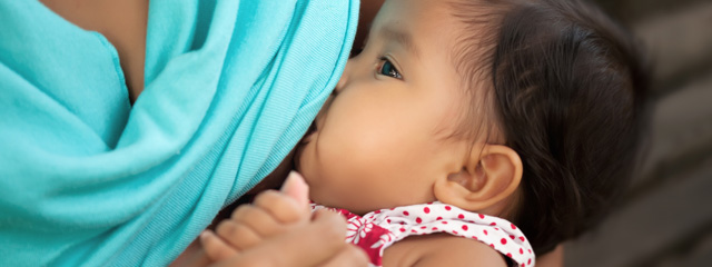 How can I wean a breastfeeding baby? | A baby breastfeeds from her mother.