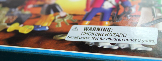 5 Tips to Avoid Unsafe Toys | Photo of a toy with a close up of the warning label that reads: Warning: Choking hazard. Small parts. Not for children under 3 years.