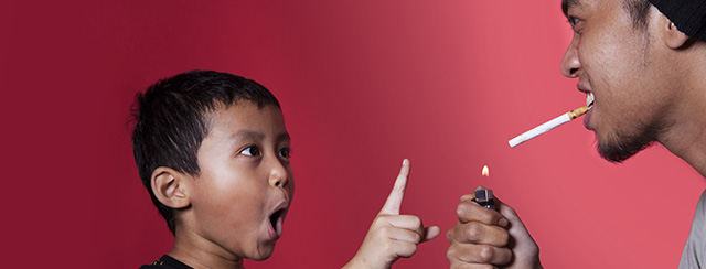 When Mom and Dad Are Smokers: Modeling Behavior | When you become a parent, lifestyle choices matter. Firsthand, secondhand, and thirdhand smoke affect kids in ways you might not even realize, like frequent sickness and asthma. Quitting smoking will model a positive behavior with your children. | A boy shakes his finger at his dad, who is about to light a cigarette.