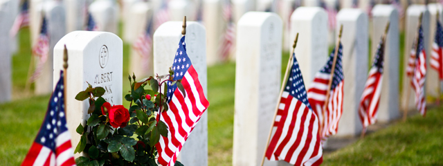 American flags decorate the graves at Arlington National Cemetery.
