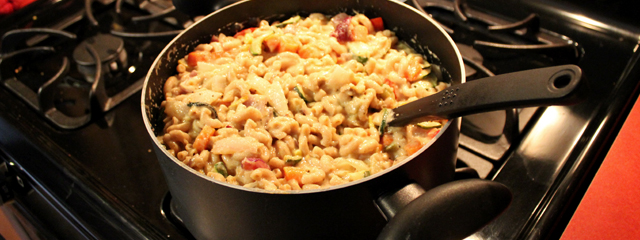 Combine the macaroni, cheese sauce, and vegetables.