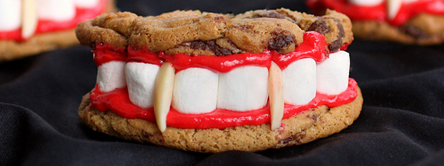 5 healthy and creative Halloween Party Foods | Dracula's dentures are made of cookies, marshmallows for teeth, red-tinted vanilla frosting for gums, and slivered almonds for fangs. | Photo and recipe via The Girl Who Ate Everything