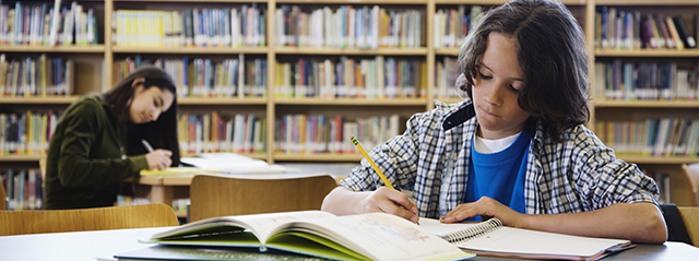 Score High with These 4 Middle School Study Tips | Middle school signals the beginning of an adult approach to academics and studying. The switch to multiple classes with different teachers prompts students to juggle deadlines and learn valuable time management skills. That's why it's critical that they develop strong study skills now to help them through middle school, high school, college, and beyond. | Two middle school students study in the library.