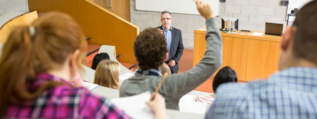 Parent Engagement in College: Academic Success | A college student raises his hand and the teacher calls on him in a lecture hall.