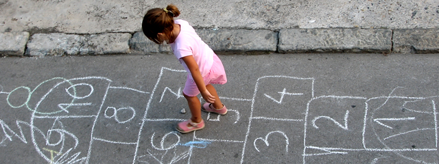 ADHD or Lack of Movement? In an article published on WashingtonPost.com, a pediatric physical therapist found that many children in the classroom aren't moving enough. | A girl plays hopscotch.