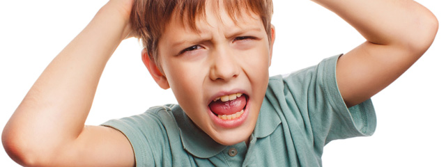 A boy angrily faces the camera.