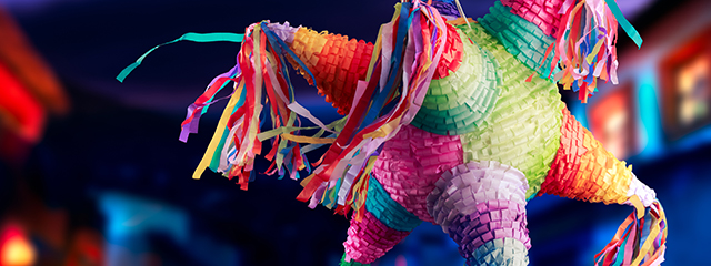 4 Family Activities to Celebrate Las Posadas | A pointed star piñata waits to be hit by children on Las Posadas.