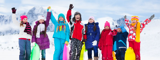 Kids celebrate in the snow