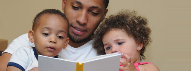 Parent Engagement in the Early Years | Several examples of how you can practice parent engagement throughout the early years—from day one through kindergarten. | A father reads with his young children.