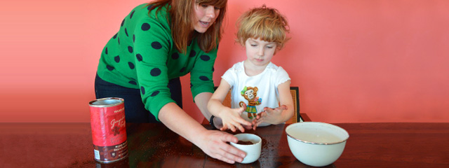 Jessica Vician helps Byrdie Von Hines measure the coffee grounds.