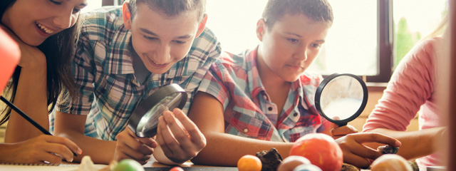 Tweens use magnifying glasses to examine objects.